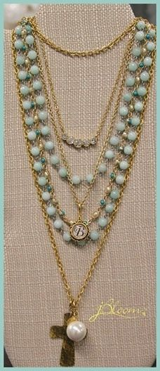 Layering with a touch of color! Tiny gold Imagine chain ($25), Turquoise and Pearl Mix chain ($50), Amazonite Link necklace ($45), Graduated Crystal and Gold necklace ($34), small decorative personalized glass initial dome pendant ($18), Gold Hammered Cross ($30) and the Large South Sea Pearl ($15). Total layered look as shown $217 - layering combinations… many! www.myjbloom.com/maryenderle to view ideas
