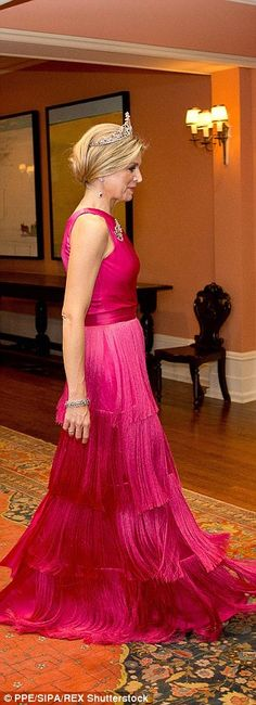 Queen Maxima's gown was rather eyecatching and swished as she walked through the reception...