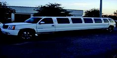 The 20 passenger Cadillac Escalade Limo is perfect for large groups like a #wedding party! #Dells #LimoKings Features: Full bar CD/MP3/Ipod/Radio Fiber optic lighting, with strobe lights
