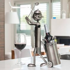 As a decorative element, to serve wine, to put a vase of flowers in, etc. The Golfer metal bottle holder will astonish with its functionality and originality. dimensions: 24 x 45 x 11 cm. Bottle Rack, Wine Bottle Holders, Bottle Stoppers, Cocktail Maker, Can Opener, Glass Bottles, Gadget, Ebay, Sport