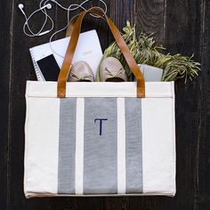 Personalized Grey Stitched Stripe Canvas Tote with Leather Handles. Pack for a weekend away with this personalized grey-stitched stripe canvas tote. Durable leather handles make the tote easy to carry, and an inside pocket holds small items securely. Cute personalized gifts for her.
