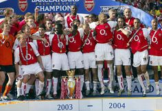 "Arsenal F.C , ""The Invincibles "" squad , winning the English Premier League  2003/20004 season without losing a single game ."