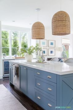 A coastal inspired kitchen with a Benjamin Moore Providence Blue island. A coastal inspired kitchen with a Benjamin Moore Providence Blue island. Kitchen Interior, Kitchen Inspirations, Coastal Kitchen, Coastal Inspired Kitchens, Kitchen Remodel, Kitchen Decor, Kitchen Renovation, Blue Kitchen Island, Kitchen Construction