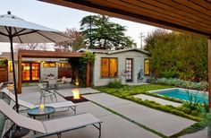 Love the coziness of this house and check out that moss/grass by the pool! So love!!
