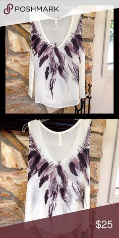 Beautiful border print blouse Feather border print v-neck sleeveless blouse. Style Biz Tops Blouses