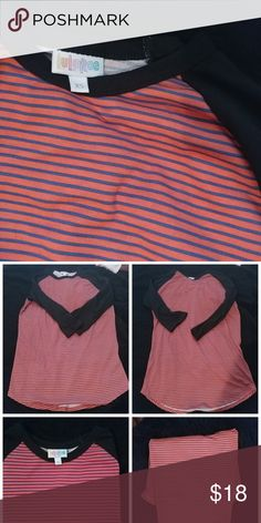 Never worn Lularoe RANDY Size XS Randy style baseball shirt. From lularoe. Known for their super soft,comfy and unique printed clothing. This top has a navy & pink striped middle section with solid black sleeves. Looks great with black leggings oe jeans. Tunic legnth so covers the rear when leggings are worn. Love the top, but have a newborn so must downsize and trade my lula love for baby love items! As with most lula items an XS can fit small or even medium ladies pending how u like it to…