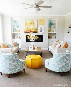 Love the combination of aqua blue and yellow in this pretty living room?  I've found 5 DIY projects to help you get this look for less at Infarrantly Creative.