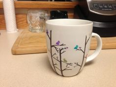 Colored Sharpie design on $5 white mug from Target, bake at 350 for 30 minutes to make permanent!  Nailed it!!!!