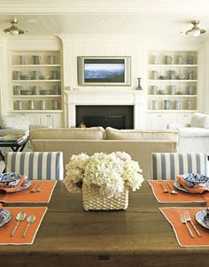 Orange dining room with gray/blue stripe chairs