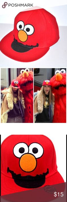 Trendy Elmo baseball cap Brand new with tags attached (ADULT SIZE)   Stretchy Flexfit cap  Super cute and trendy style   As seen on Cara Delevingne  Officially Licensed Sesame Street Product  100% Cotton  One size fits most Urban Outfitters Accessories Hats