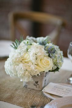 Rustic, elegant centerpieces featuring hydrangeas, roses, cornflowers, and thistle. {Happy Confetti Photography}