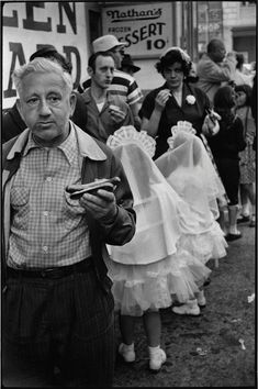 Coney Island. New York, 1955. Photo: Elliott Erwitt. (Love that he included the detail of little girls in Communion dresses)