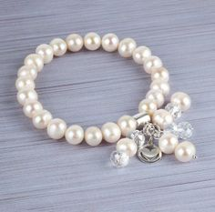 Learn how to make this Winter Ice Pearl Bracelet using shining white freshwater pearl beads, Chinese crystal faceted rondelles and Sterling Silver findings and. Pearl Bracelet, Pearl Necklace, White Freshwater Pearl, Pearl Beads, Other Accessories, Handmade Jewelry, Jewelry Making, Ice, Pearls