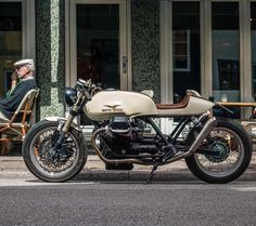 Hanging out at the cafe is this gorgeous Moto Guzzi SPII racer built by . Photo by . Moto Guzzi 850, Moto Guzzi Motorcycles, Guzzi V7, Cafe Racer Motorcycle, Motorcycle Outfit, Cafe Bike, Custom Cafe Racer, Cafe Racer Build, Vintage Bikes