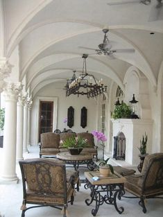 gorgeous veranda with a fireplace... great use of wrought iron Architectural Landscape Design