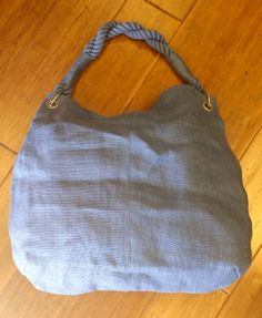 Stradivarius blue jute bag, $15.