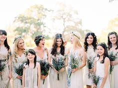 Bridesmaids' dresses: Free People, Urban Outfiters and Etsy/ Bride's gown: Anna Sui for BHLDN/ Jewellery: Free People, Anthropologie, Gypsy Junkie - Stylish Austin Wedding with a touch of Boho by Marion H Photography - via Magnolia Rouge