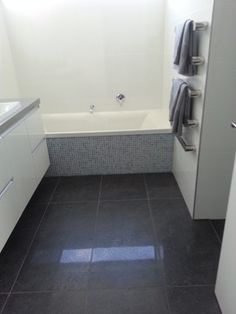 Slate colored floor?  Riviera Anthracite & Easy White Gloss Bathroom - 1 Lombardia Way, Karaka - contemporary - bathroom tile - auckland - Heritage Tiles
