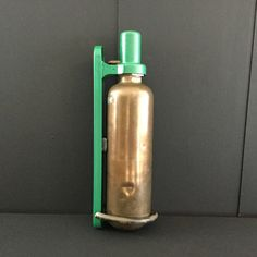 Antique military vehicle fire extinguisher in holder. Mantique. Military collectibles.