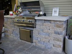 Celtik stone outdoor kitchen with limestone countertop. #TopekaLandscape