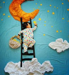 'Wengenn in Wonderland' - photo by Queenie Liao, a freelance Chinese artist who lives in California;  Liao fabricates dreaming scenes using cloths, household materials, and toys, placed all around her sleeping baby (Wengenn) in a way that seems to the viewer as if he's participating in the scenes.