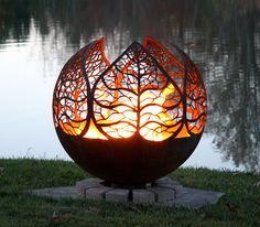 "Autumn Sunset | Leaf Fire Pit Sphere 37"". Leaf designs surround this unique artisan fire bowl by Melissa Crisp and features an open top and flat steel base."