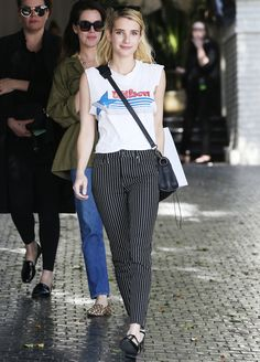 Emma Roberts Makes a Wilson Sporting Goods T-Shirt and Striped Pants Look Oh So Cool from InStyle.com