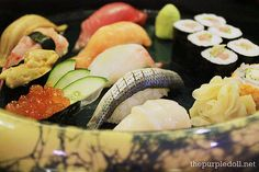 Take Nigiri Sushi -- ikura (salmon roe), uni (sea urchin), ebi (shrimp), anago (sea eel), hotate (scallop), kohada (spotted sardine), tai (red snapper), shake (salmon) and maguro (tuna) nigiri sushi, and California and maguro maki