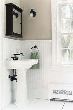 High Contrast Powder Room Dark Walls White Beadboard