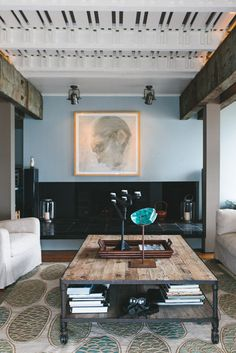 Reclaimed wood elements could soften all the modernity.  Nice color palette here too, blues and greens would look good against the grey paint