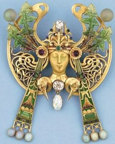 René Lalique 1900 Brooch. Gold, diamonds, emeralds, peridots, amethysts, opals, enamel, glass.