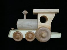 """5 cars - roughly 2 1/2"""" wide and 22"""" long Around the bend, across the bridge (or the kitchen table) delivering the freight to the next town. Snow, rain or wind - this freight train is always on time!"""
