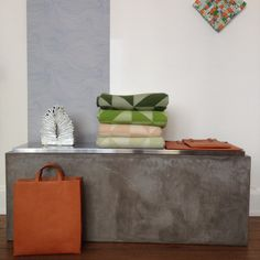 Seascape wallpaper by Abigail Edwards, blankets and wall hanging by Tina Ratzer, sculpture by Louise Gaarmann, leather bag and folders by Antiatoms.
