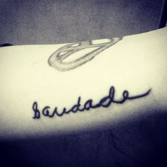 """Saudade, """"the love that remains.""""  I took the """"S"""" from my oldest brother's signature, and my other brother wrote out the rest for me. Scott's death by suicide was easily the hardest thing I've ever had to go through; getting this tattoo was a coping method for me that will hopefully also be a positive reminder of the 19 years my brother was alive, and the impact he made on my life."""