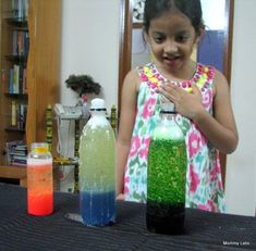 """homemade """"lava lamp"""" science experiment. Oil, water, food coloring, alka-seltzer."""