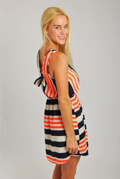 Oh Sweet Sailor Of Mine! Adorable navy and neon orange stripe bow back dress. Elastic band at the waist. Conservative, yet cute open back with a bow. Bra friendly. Made of 100% poly, unlined. Marissa is 5,5″ tall and a size 2. She is wearing a small. This garment fits true to size: Small 2/4, [...]