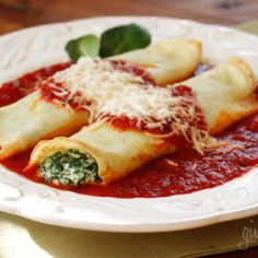 The secret to irresistible manicotti is to make them from scratch with homemade crespelles, which are basically Italian crepes. These are filled with spinach, egg and three cheeses and topped with homemade sauce. Filling and delicious!