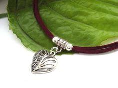Silver tone heart cord necklace
