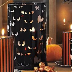 All eyes are on you! Ghoulish glances glow red when lit with a pillar candle or tealight tree, not included. Sprayed-black glass sleeve with metal base. Halloween decorations, pumpkins, bats, scary, fall