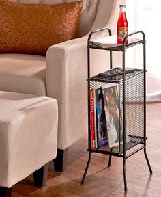 Minimize mess in any room with the sturdy Slim Metal Organizing Table. It features 2 upper shelves and a bottom compartment that's ideal for magazines, books, newspapers and more. Four rubber feet pre