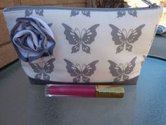 For all the butterfly lovers!  Handcrafted White and Gray Butterfly Zippered by AShop4Kicks, $12.75