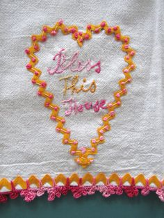 Very unusual hand made tea towel with crochet, rick rack and embroidery.  From etsy seller twolittlechickadees.
