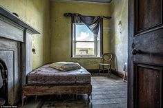This picture, taken on the Isle of Ensay, shows an abandoned bedroom with a neatly folded ...