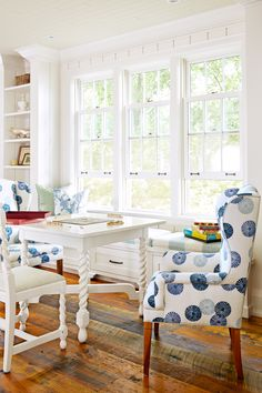 Classic wingback chairs get an upgrade with a fresh print from Lee Jofa. Paired with a white game table, they make the house's library a cozy gathering spot.   - HouseBeautiful.com