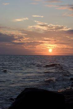 Sunny shores & dark skies