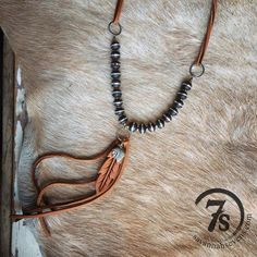"""Chatham Necklace - Leather and bead necklace. Wood and silver beads. Hand tooled feather. Deerskin leather tie and fringe. Silver Indian Head Coin - note slightly different than pictured.19"""" long. Handcrafted in Texas by J.Forks Designs."""