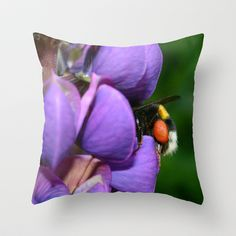 """Lupine and bumblebee Throw Pillow by gunadesign - $20.00 Throw Pillow Cover made from 100% spun polyester poplin fabric, a stylish statement that will liven up any room. Individually cut and sewn by hand, the pillow cover measures 16"""" x 16"""", features a double-sided print and is finished with a concealed zipper for ease of care."""