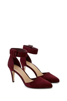 A pair of faux suede pumps featuring a buckled ankle strap and pointed toe.