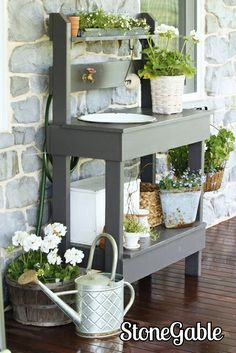 Love the outdoor water faucet/hose and enameled sink in the potting bench