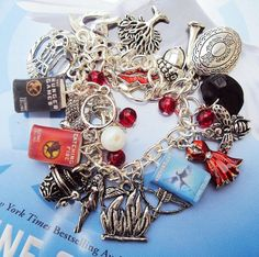 Hunger Games charm bracelet  @Kim Zoot Holmes this made me think of you!